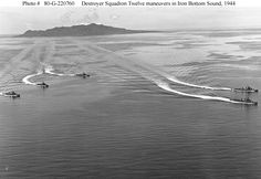 """Destroyer Squadron Twelve:  Five DesRon12 destroyers make formation """"S-turns"""" in Iron Bottom Sound, off Guadalcanal. Savo Island is in the distance."""