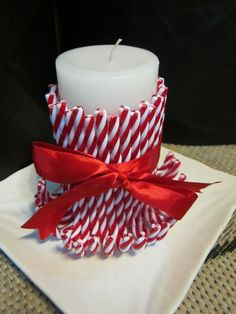 This candle is adorable! There are no directions but looks like all you need is some candy canes and some ribbon. Maybe use a hot glue gun to help keep them in position. I know I always tend to have candy canes left over from the year before, they are still good but no longer edible. Love it!