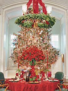 At his Manhattan design studio and showroom, designer Richard Keith Langham hosts his usual holiday dinner for eight with the table under an iron-wreath chandelier on axis with his 20-foot-tall Christmas tree.