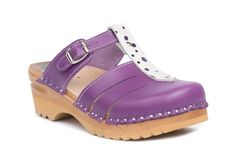 Closed toe clog sandal with an adjustable strap over the instep in a mix of purple and purple polka leather.