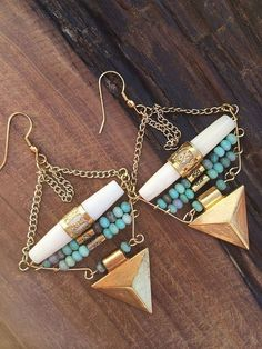 Emotion behind the making: This woman is a traveler of life. She loves to explore new things and places. You never know what she's really thinking. Handmade: Uniquely shaped dangle earrings. Materials