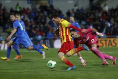 Barcelona's Lionel Messi, front, scores   during a Spanish Copa del Rey match between FC Barcelona and Getafe at the Coliseum Alfonso Pe...