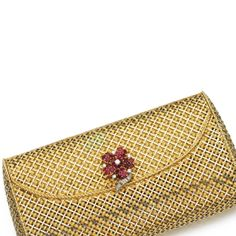 Lady's ruby and diamond evening bag, Of open basket weave design, the clasp decorated with a floral motif set with circular-cut rubies and brilliant-cut and baguette diamonds, opening to reveal a mirror; Ringo Starr, Vanity Case, Gold Clutch, Clutch Purse, Baguette Diamond, Floral Motif, Basket Weaving, Evening Bags, Handbag Accessories