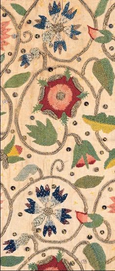 woman's embroidered linen coif detail