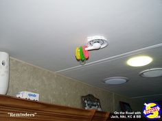 """Colorful """"reminders"""" on your RV antenna handle tell you that something must be done before moving your rig. Our 3 are 1. Antenna down, 2. Outside motion lights taken down, 3. Indoor/Outdoor thermometer in. Then the 3 wristbands go on our shift lever until the next stop. Light Take, Camper Trailers, Camping Tips, Motorhome, Caravan, Track Lighting, Indoor Outdoor, Rv, Handle"""