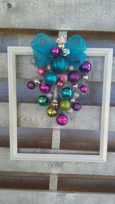 My Handmade Blue Pink and Purple candy colored Christmas Framed Wreath for my neice