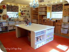 Amanda of the Ivy Cottage Blog transformed her garage into a highly functional craft room, complete with a gigantic work table and ample storage space.