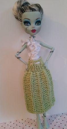 Pretty silky white hand sewn white top and hand knit green skirt. You can find it at etsy.com and my store name is bffknits. :-)