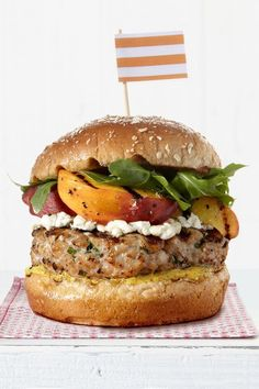 This delicious pork burger is topped with juicy peaches and tangy goat cheese for one decadent summer sandwich.