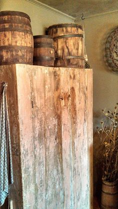 Primitive cabinet with small barrel and keg