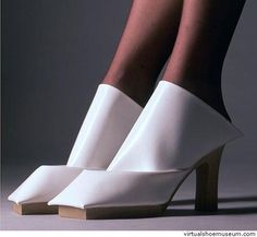 The material for this shoe has been folded once and makes this abstract shoe shape. In the inside of this shoe, is a slipper detail hidden, which makes the shoe wearable.