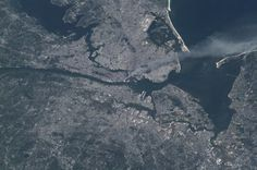This is a photo of the smoke rising from Lower Manhattan following the events of 9/11/01, as seen from space.