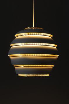 Alvar Aalto (Finnish) | Beehive Lamp for Artek, A331, c.1953 | Black painted aluminium, polished brass plated steel rings | Maija Holma, Alvar Aalto Museum.