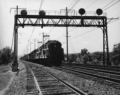 P5a's on a PRR freight  Two Pennsylvania Railroad P5a electrics roll northward with a freight at Halethorpe, Md., in the 1940s. Early P5a's had box-cab carbodies