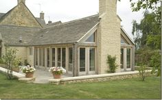 Fabulous oak garden room with stone chimney breast on the gable end.