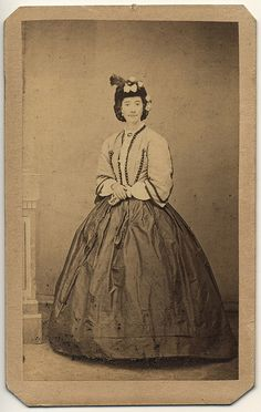 cdv 1860s woman in contrasting coloured bodice and skirt with hat rather than bonnet.