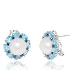 Beautiful fresh water pearls crowned with alternating blue topaz (4.4 ct) and black diamonds (0.16 ct). 18k White Gold Earrings