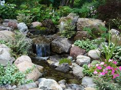 Waterfall Ponds, Retaining Walls, Lighting, Walkways, and Low Maintenance Gardens by Acorn Landscaping in Rochester NY Waterfall Design, Waterfall Fountain, Outdoor Ponds, Outdoor Gardens, Landscape Design, Garden Design, Backyard Landscaping, Landscaping Ideas, Garden Stones