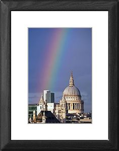 22x18 (56x46cm) Framed Print featuring Rainbow over St. Paul's Cathedral and the City of London, England. A shower of rain just before sunset produced a beautiful rainbow stretching across the River Thames and the City of London including St. Paul's Cathedral.. Wood grain effect frame with professionally mounted print. Overall outside dimensions are 22x18 inch (566x465mm). Features hardboard back stapled in with hanger and glazed with durable Styrene Plastic to provide a virtually…
