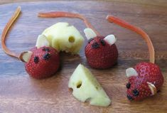 """Strawberry Mice. Almond sliver ears, raisins eyes and nose, fruit leather tails and even """"cheese"""" made from apple slices."""