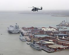 The huge aircraft carrier, which weighs a staggering 65,000 tonnes, could be seen in Ports...