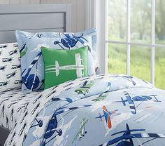 Provide your child's sleep space with superior comfort and a playful design. This soft duvet cover boasts a pleasing pattern of old-timey airplanes soaring through the clouds.