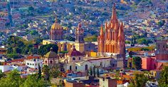 Panoramic view of San Miguel de Allende, Guanajuato, Mexico . towering above the town is the Parroquia de San Miguel Arcángel Monuments, Visit Mexico, Mexico Travel, Travel And Leisure, Best Cities, Mexico City, World Heritage Sites, Beautiful Places, Stunningly Beautiful