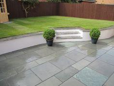 slate garden tiles top of wall Garden Slabs, Slate Garden, Garden Retaining Wall, Slate Patio, Garden Tiles, Garden Paving, Walled Garden, Patio Wall, Small Retaining Wall