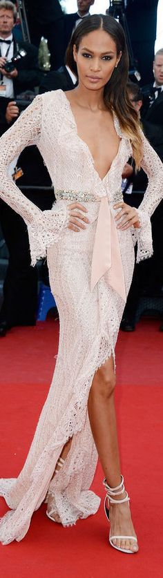 Joan Smalls in a long lace low-cut gown.