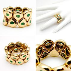 Gold Emerald movable link ring.