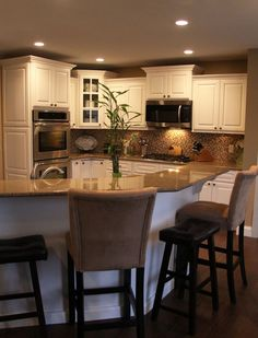 L shaped kitchen layout with an arched overhang on the Energy efficient kitchen design
