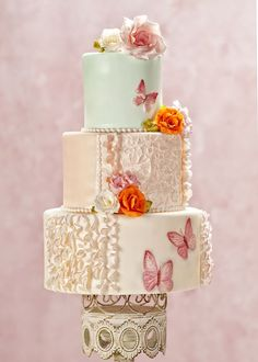 My Butterfly Blush design for Cake Central Magazine Vol. 4 Issue 2.  Hand painted 2D &3D butterflies, brush embroidery lace, and  pink tipped ruffles.