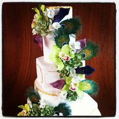 Elegantly Iced cakes - the peacock feathers are made of sugar. @Lindsey Gamble is a sugar master.
