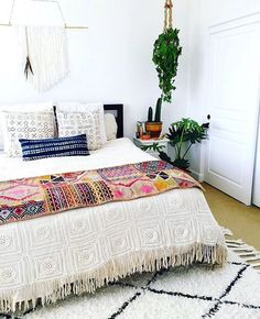 bohemian bedroom full of texture and plants