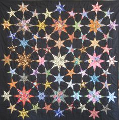 Batik Bintang quilt by Hilde Hoogwaerts-Cayman. 5 point, 6 point and 8 point stars combined in one quilt.
