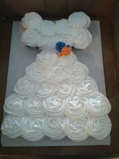 Cupcake cake in the shape of a wedding dress for a bridal shower. Bling for a belt, and roses in the bride's colors.