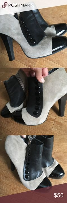 Fashion booties If you love to set a trend and turn heads with your shoes - look no further. These are adorable and stylish suede booties with black faux leather spats and buttons on the side. Inside side zip. Gianni Bini Shoes Ankle Boots & Booties
