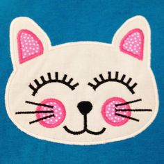 Cute cat face machine applique design. Perfect little kitty for a little girl who loves cats!