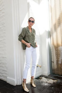 White and army green- and neither pieces that I have. White pants and an army green top? Safari top?