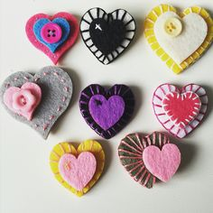 Homemade felt stitched brooches