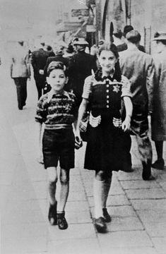 Jewish children wearing the compulsory yellow badge. In September 1943, they were deported to Auschwitz.<br>Antwerp, Belgium, 1943.
