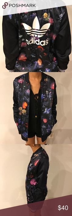 Adidas Zip-Up Jacket Perfect condition Adidas floral print zip-up jacket! An overall navy blue, blush floral pattern with the trefoil design on the back and a little embroidered one on the front! Marked as a size large, but fits the model who is a size small. Adidas Jackets & Coats