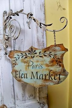Paris flea market advertising sign hanging from an ornate bracket. Would love this sign hung in a French country cottage! French Cafe Decor, French Country Decorating, Country French, French Style, French Signs, Paris Flea Markets, Flea Market Style, Kitchen Themes, Shabby Chic Kitchen
