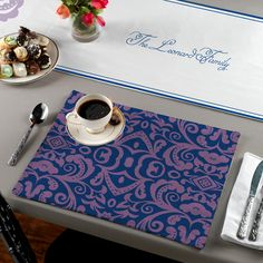 "Elegant flourishes adorn this personalized table runner. Pair it with our Violet Damask placemat set TBP-HWN-L to complete the look. Table runners measure 16"" x 72""."