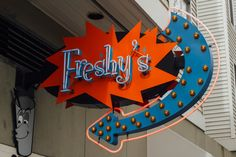 Brightly colored neon sign for Freshy's in Seattle, WA