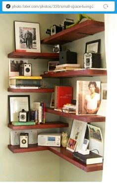 Cool Corner!  Clever way of maximizing corner space, with floating shelves and different shelf heights. #apartmenttherapy