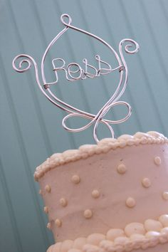 Fleur de Lis Custom Name Wedding Cake Topper. $45.00, via Etsy.