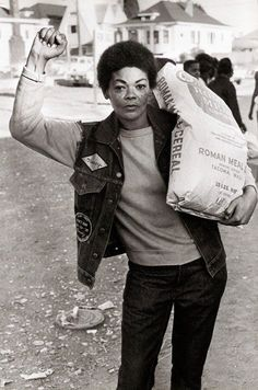 Member of the Black Panther Party for Self Defense at the Free Breakfast for Children Program in Oakland, California, 1971.
