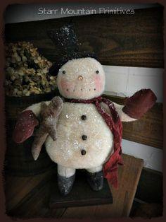 Primitive Snowman with Gingerbread man.  https://www.facebook.com/Starr-Mountain-Primitives-228548684018/timeline/