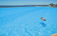 Lost at sea: A bather floats on the amazingly clear waters of the vast Crystal Lagoon, at the San Alfonso del Mar resort, Chile  ( worlds largest swimming pool)